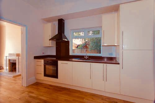 Kitchen with granite worktops and integrated dishwasher and